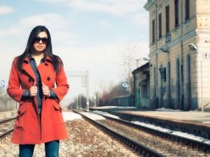 The girl with the orange coat