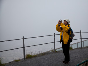 Japanese woman with camera in fog